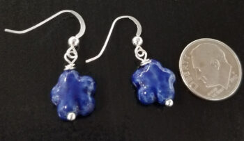 dark blue daisy earrings with dime for scale