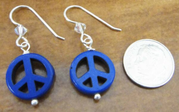 handmade dark blue peace sign and crystal earrings with dime for size