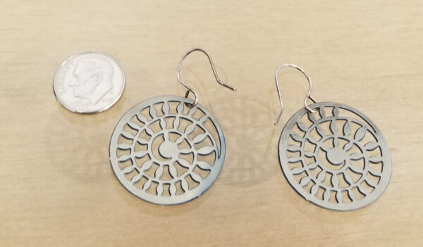 backside of earrings with dime for scale