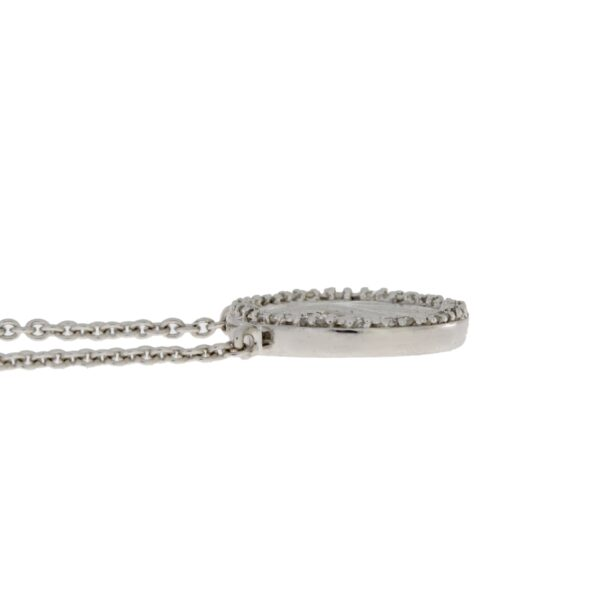 side view of diamond and peace sign necklace