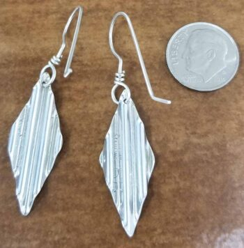 These sterling silver earrings are shown here with a dime for scale.