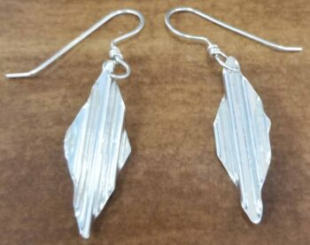 These sterling silver earrings were handmade by Iowa designer Dale Repp.