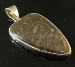fossilized dinosaur bone and sterling silver triangle pendant