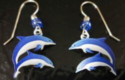 These double dolphin earrings are handmade by Sienna Sky.