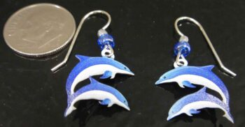 These double dolphin earrings are handmade by Sienna Sky with dime for scale.
