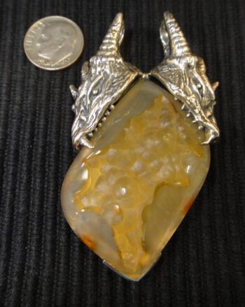 sterling silver two headed dragon and tan druzy pendant with dime for size