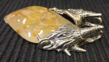 side of sterling silver two headed dragon and tan druzy pendant