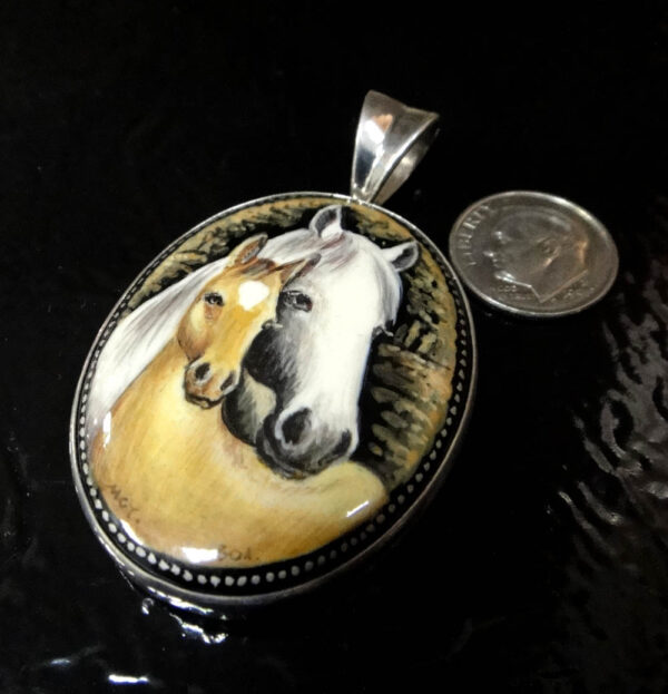mare and colt hand painted black agate and sterling silver pendant with dime for scale