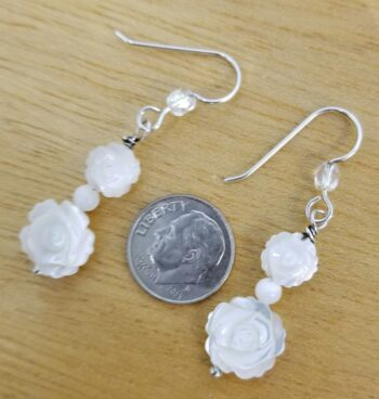 carved mother of pearl flower earrings with dime for scale