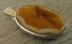handmade orange druzy and sterling silver pendant by Dale Repp
