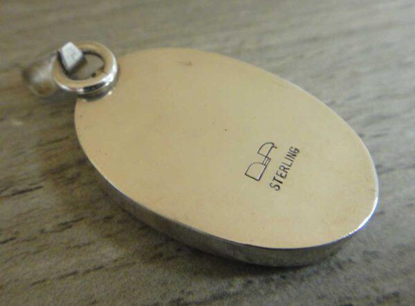 back of orange druzy pendant