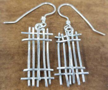 Sterling silver line design dangle earrings handmade by Dale Repp in Lone Tree, Iowa