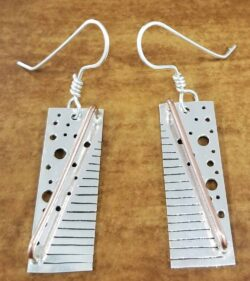 These sterling silver and copper earrings are handmade by Dale Repp.