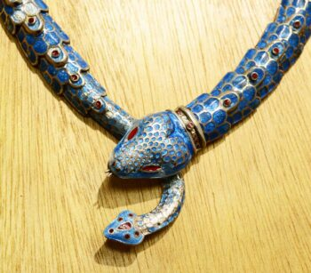 close-up of detailed sterling silver and enamel snake statement necklace handmade in Taxco, Mexico