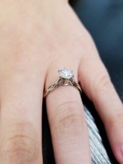 Diamond and white gold engagement ring on hand
