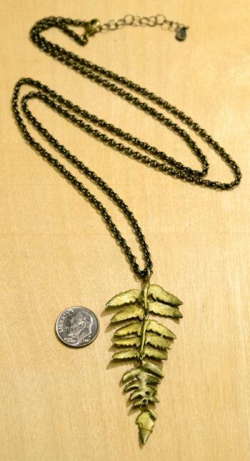 Back view of Michael Michaud's Silver Seasons long fern pendant necklace