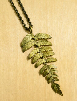 Close up of Michael Michaud's long fern pendant necklace
