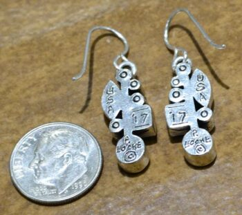 back of Frostbite earrings by Patricia Locke with dime for size