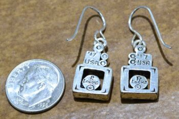back of Picture Window earrings by Patricia Locke with dime for size