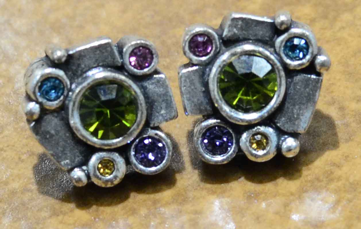 These stud earrings are handmade by Patricia Locke Jewelry. Patricia Locke names each style and this earring style is called Rindonada. These earrings feature Patricia Locke's color palette named Fling.