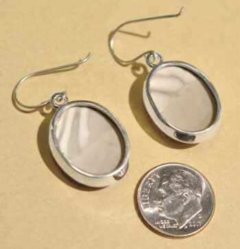 back of brown flint and sterling silver oval drop earrings with dime