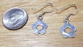 back of sterling silver daisy flower earrings with dime for size