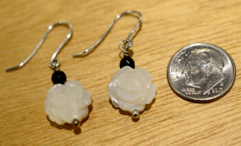 carved flower mother of pearl and black onyx beaded earrings with dime