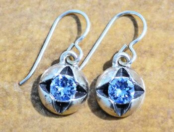 These dangle earrings are handmade by Patricia Locke Jewelry. Patricia Locke names each style and this earring style is named Fortune Teller. These earrings feature Patricia Locke's blue crystal stone named aquamarine.