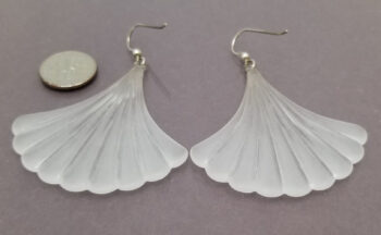 back side of frosted vintage lucite earrings with dime for scale