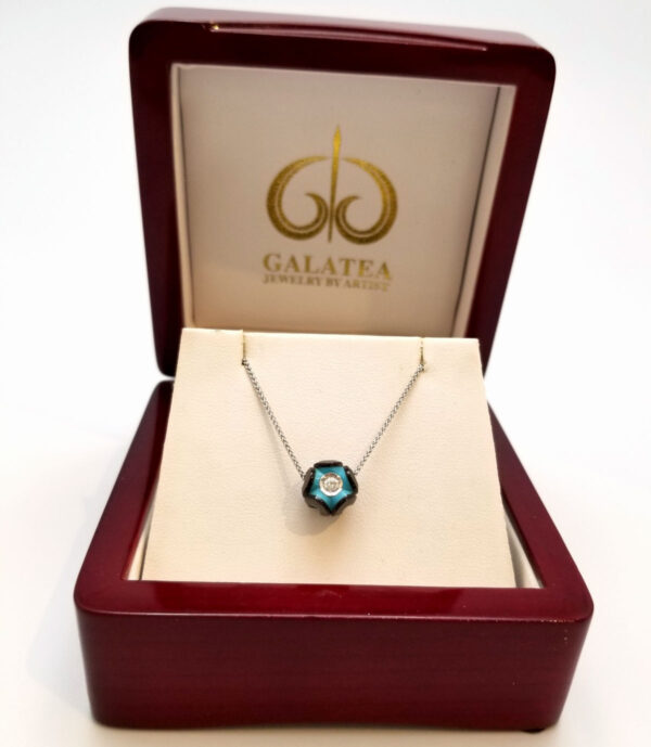 Galatea Black pearl necklace with turquoise and diamond center