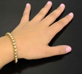 Game, Set, Match gold tone bracelet by Patricia Locke modeled on wrist