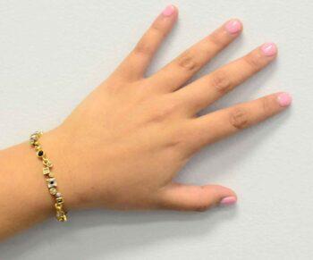 Garden Path two tone bracelet by Patricia Locke modeled on wrist