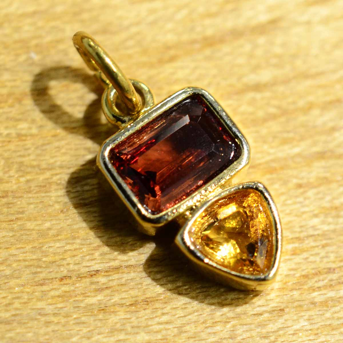 This gold vermeil garnet and citrine pendant was handmade by Sonoma Art Works.