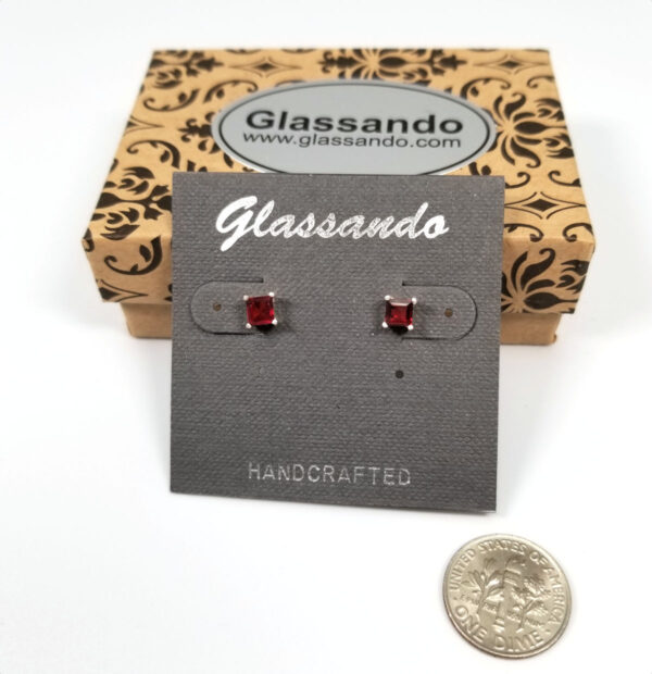 garnet square stud earrings with box and dime for scale