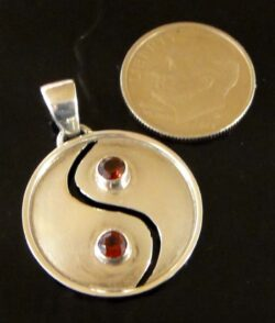 garnet and sterling silver yin yang pendant with dime for size