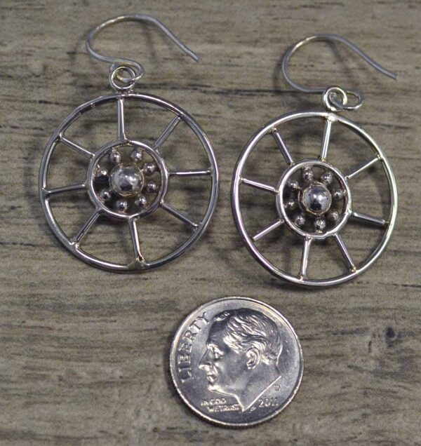 back of gaspeite earrings with dime for size