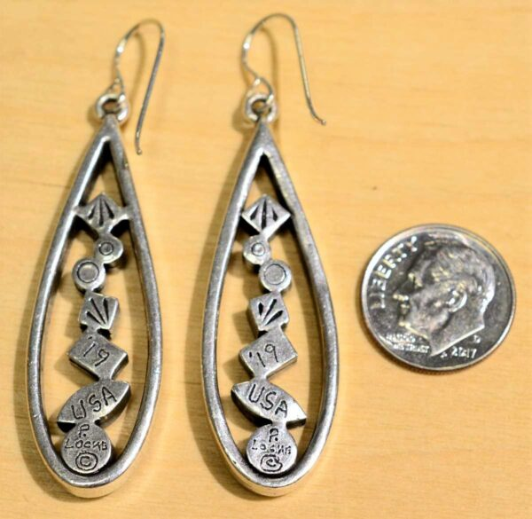 Back of Patricia Locke Geometric Progression silvertone earrings, shown with dime (not included) for scale