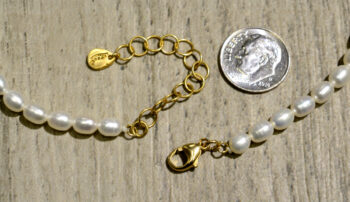 Clasp of gold vermeil ginkgo leaf necklace with freshwater pearls, shown with dime (not included) for scale