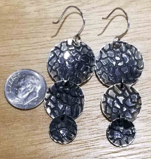 back of sterling silver giraffe print earrings with dime for size