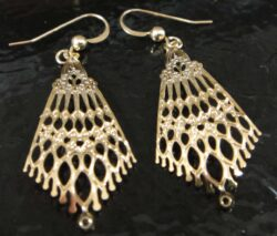These fan shaped gold-tone filigree earrings are handmade by Adajio.