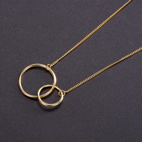 yellow gold-plated interlocking circles necklace on black background