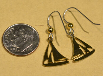 back of Sienna Sky goldtone sailboat earrings with dime