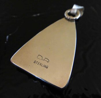 back of graveyard point plume agate pendant