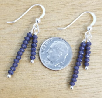 gray beaded earrings with dime for scale