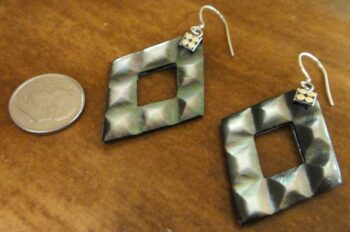 gray mother of pearl earrings with dime for size
