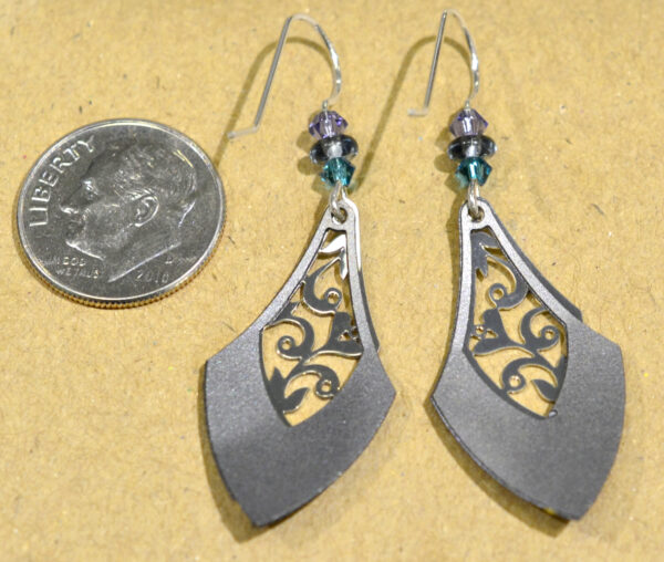 back of gray, purple, teal drop Adajio earrings with dime