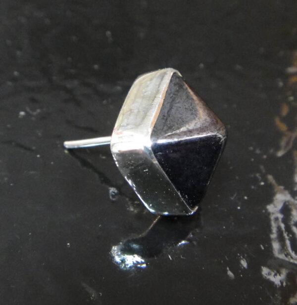 side of 3D gray pyramid stud earrings