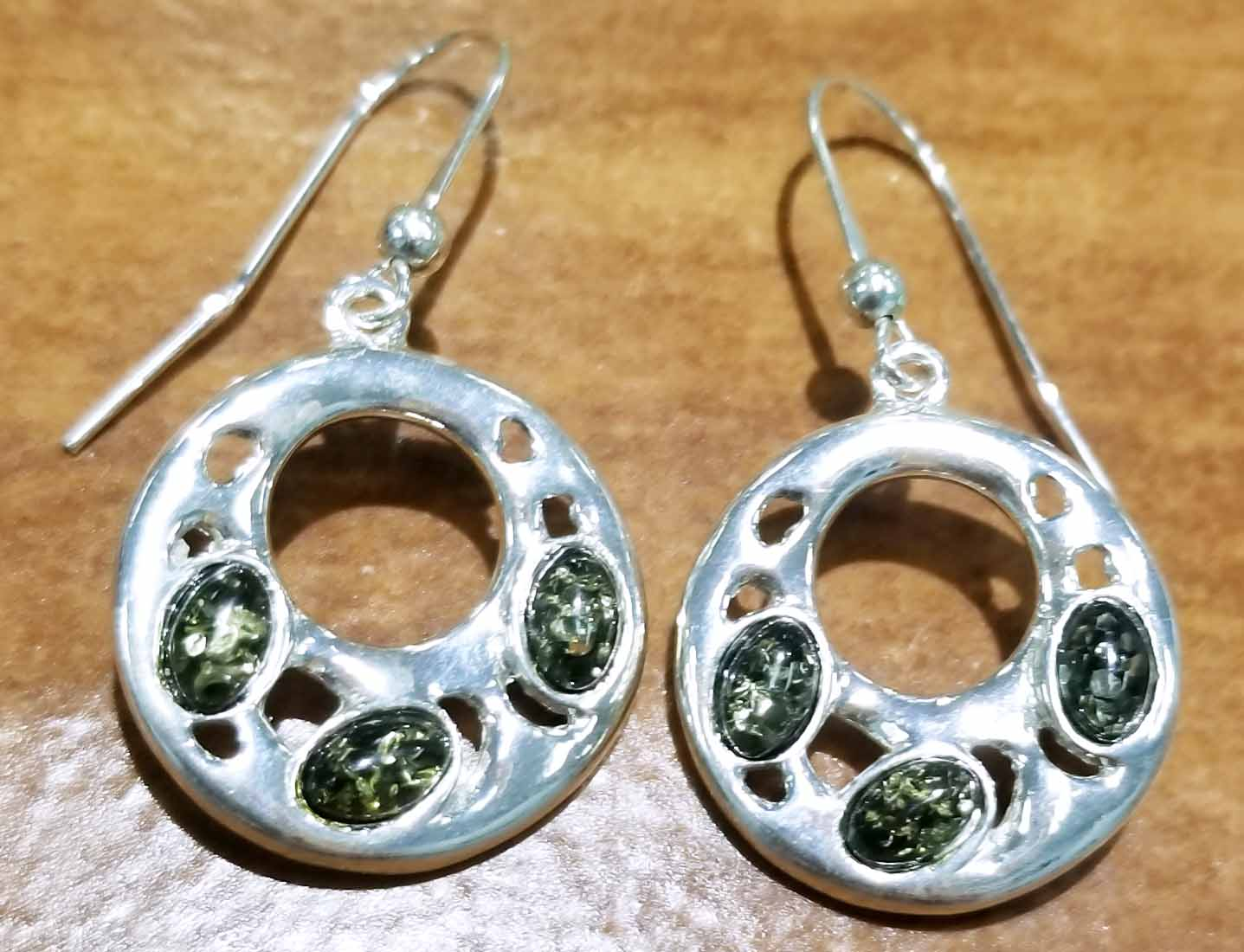 Baltic green amber and sterling silver hoop earrings