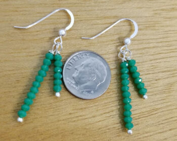 green beaded earrings with dime for scale