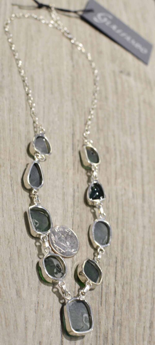back of rough green obsidian necklace with dime for size